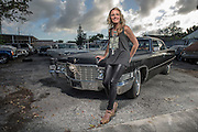 TUESDAY FEBRUARY 2, 2016 WEST PALM BEACH, FL - Heidi Lynn Ferguson poses with her 1969 E\Sedan de Ville in West Palm Beach, FL. Ferguson is a young corporate flight attendant who loves her cars, she also owns a 1976 Eldorado, much to the chagrin of her children. Photo by Josh Ritchie