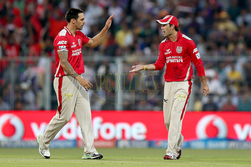 Mitchell Johnson is congratulated by his teammates after taking the wicket of Ryan ten Doeschate during the first qualifier match (QF1) of the Pepsi Indian Premier League Season VII 2014 between the Kings XI Punjab and the Kolkata Knight Riders held at Eden Gardens Cricket Stadium, Kolkata, India on the 28th May 2014. Photo by Jacques Rossouw / IPL / SPORTZPICS<br /> <br /> <br /> <br /> Image use subject to terms and conditions which can be found here:  http://sportzpics.photoshelter.com/gallery/Pepsi-IPL-Image-terms-and-conditions/G00004VW1IVJ.gB0/C0000TScjhBM6ikg