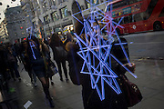 Neon tubes reflected in a retailer's window on London's Oxford Street.