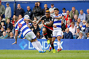 Nottingham Forest forward Britt Assombalonga (9)  leaves his foot in on Queens Park Rangers defender Joel Lynch (6) as he makes a clearance during the EFL Sky Bet Championship match between Queens Park Rangers and Nottingham Forest at the Loftus Road Stadium, London, England on 29 April 2017. Photo by Andy Walter.