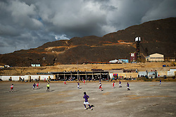 Morococha residents watch a soccer match Sunday afternoon at the local field. This photograph was taken months before residents started moving out for Carhuacoto. More than 5000 people lived in Morococha.