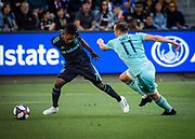 LAFC forward Latif Blessing (7) moves the ball against Seattle Sounders defender Brad Smith (11) during a MLS soccer match in Los Angeles, Sunday, April 21, 2019. LAFC defeated the Sounders 4-1. (Ed Ruvalcaba/Image of Sport)