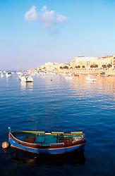 MALTA ST. JULIAN JUL00 - A traditional Maltese fishing boat in the bay of St. Julian on Malta.....jre/Photo by Jiri Rezac....© Jiri Rezac 2000....Tel:   +44 (0) 7050 110 417..Email: info@jirirezac.com..Web:   www.jirirezac.com
