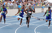 Jul 26, 2019; Des Moines, IA, USA; Christian Coleman (second from right)) defeats Michael Rodgers (right), Isaiah Young  (left) and  Ronnie Baker (second from left) to win the 100m in 9.99 during the USATF Championships at Drake Stadium.