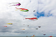 Kite festival of bright color kites in the sky above Fano Island - Fanoe - South Jutland, Denmark