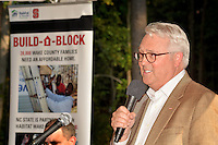 Chancellor Randy Woodson addresses the crowd gathered for at the Build-A-Block Habitat for Humanity project ceremony.