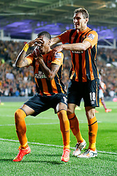 Hull City's record new signing Abel Hernandez, making his club debut, celebrates with a dance after scoring the opening goal of the game, as Nikica Jelavic of Hull City looks on  - Photo mandatory by-line: Rogan Thomson/JMP - 07966 386802 - 15/09/2014 - SPORT - FOOTBALL - KC Stadium, Hull - Hull City v West Ham United - Barclays Premier League.