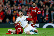 Liverpool midfielder Jordan Henderson (14) tackles AS Roma forward Edin Dzeko (9)  during the Champions League semi final leg 1 of 2 match between Liverpool and Roma at Anfield, Liverpool, England on 24 April 2018. Picture by Simon Davies.