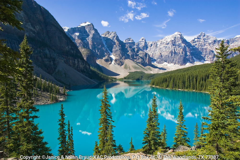 Moraine Lake in Banff National Park, Alberta, Canada. The turquoise hue in the water is due to sunlight reflecting off glacial silt created by glaciers grinding rocks into powder. The mountains are called the Seven Sisters.