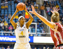 West Virginia Mountaineers forward Kayla Montgomery (4) passes the ball against the Oklahoma Sooners during the first half at the WVU Coliseum.