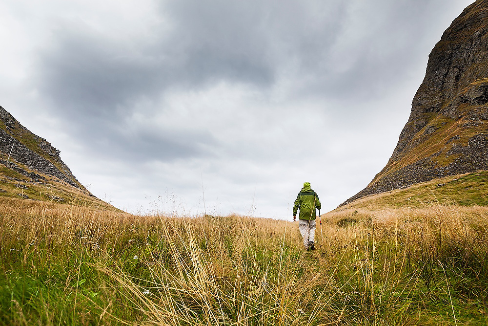 Liana Welty hikes through a pass on Vaeroy Island, Lofoten Islands, Norway.