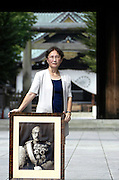 "Yuko Tojo, granddaughter of Japan's wartime leader, General Hideki Tojo, poses with a photo of her grandfather outside Yaskuni Shrine in Tokyo. Gen. Hideki Tojo - who ordered the attack on Pearl Harbor -- was charged and hanged as a war criminal after World War II when Yuko was just 6, and he is enshrined inside the controversial Yasukuni Shrine together with 13 other convicted war criminals. Though she remembers little of her grandfather she still regards him as a hero. ""Japan did not fight a war of aggression but in self-defense,"" says Ms. Tojo, widely seen as a leading figurehead in a recent surge in nationalism in Japan and who unsuccessfully ran for a seat in Japan's House of Councilors in 2007. ""Japanese children are only taught about the evil things our country and their ancestors did during the war and this has led to a lack of pride in the Japanese people, which is wrong. We must reinstall a sense of pride and confidence in our children."""