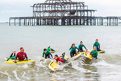 © Licensed to London News Pictures. 16/11/2019. Brighton, UK. Members of the Brighton Surf Life Saving Club brave the very cold weather to take part in their weekly training session in the Brighton and Hove sea. Photo credit: Hugo Michiels/LNP