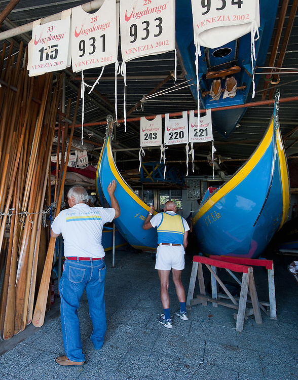 VENICE, ITALY - SEPTEMBER 04:  Members of the Voga Veneta Lido arrange a gondola during some final preparations  ahead of Sunday Historic Regata on September 4, 2010 in Venice, Italy. The Historic Regata is the most exciting rowing race on the Gran Canal for the locals and one of the most spectacular ***Agreed Fee's Apply To All Image Use***.Marco Secchi /Xianpix. tel +44 (0) 207 1939846. e-mail ms@msecchi.com .www.marcosecchi.com