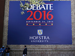 NEW YORK, Sept. 26, 2016 (Xinhua)  -- Photo taken on Sept. 26, 2016 shows the debate poster on the wall outside the media center for the first U.S. presidential debate at Hofstra University in New York, the United States. The first of three presidential debates between the Democratic and Republican nominees, Hillary Clinton and Donald Trump, will be held Monday at Hofstra University in New York. (Xinhua/Qin Lang) (Credit Image: © Qin Lang/Xinhua via ZUMA Wire)