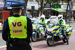 "© Licensed to London News Pictures. 13/08/2011. London, UK. There was a heavy police presence at the march. People march through London. The ""give our kids a future"" march was called by the North London Assembly, a temporary assembly in reaction to the riots in Tottenham and Hackney. It included many Turkish and Kurdish groups. Photo credit: Bettina Strenske/LNP."