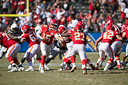 Kansas City Chiefs quarterback Patrick Mahomes (15) hands off the ball to Kansas City Chiefs running back Kareem Hunt (27) in the fourth quarter during the 2018 regular season week 1 NFL football game against the Los Angeles Chargers on Sunday, Sept. 9, 2018 in Carson, Calif. The Chiefs won the game 38-28. (©Paul Anthony Spinelli)