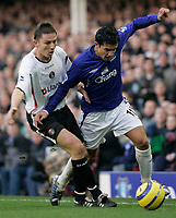 Photo: Dave Howarth.<br /> Everton v Charlton Athletic. The Barclays Premiership.<br /> 02/01/2005.  Everton's Tim Cahill battles with Charlton's Matt Holland