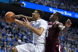 Kentucky guard Jamal Murray, left, has his shot contested by Mississippi State guard Travis Daniels in the second half. The University of Kentucky hosted Mississippi State, Tuesday, Jan. 12, 2016 at Rupp Arena in Lexington.