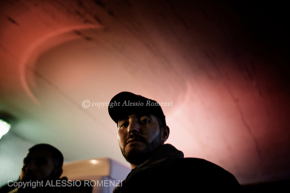 Gaza: An Hamas policeman stands in front of the Al Shifa hospital in Gaza as the siren of an ambulance lights the sealing of the E.R. entrance. November 17, 2012. ALESSIO ROMENZI