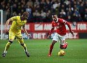 Charlton Athletic defender Tareiq Holmes-Dennis taking on Leeds United defender Gaetano Berardi during the Sky Bet Championship match between Charlton Athletic and Leeds United at The Valley, London, England on 12 December 2015. Photo by Matthew Redman.