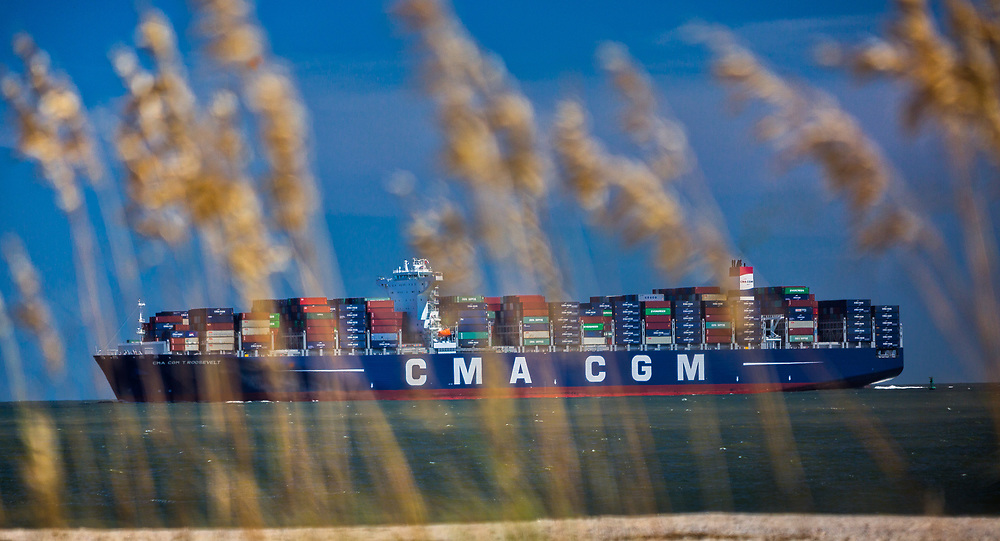 The 14,000 TEU container ship CMA CGM Theodore Roosevelt sails up river past Tybee Island, Ga., Friday, Sept., 1, 2017, to the Port of Savannah in Garden City, Ga.  (GPA Photo/Stephen Morton)