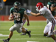 Kennedy's Miles Moa (25) tries to get around Washington's Clayton Bjornsen (7) on a run during their game at Kinston Stadium in Cedar Rapids on Friday, August 30, 2013.