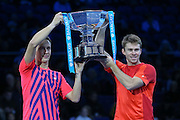 Henri Kontinen (Finland) left and John Peers (Australia) celebrate their victory and hold the trophy during the doubles final of the Barclays ATP World Tour Finals at the O2 Arena, London, United Kingdom on 20 November 2016. Photo by Phil Duncan.