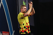 Dimitri Van den Bergh beats Mensur Suljovic in the third round and celebrates during the PDC World Darts Championship at Alexandra Palace, London, United Kingdom on 28 December 2017. Photo by Shane Healey.