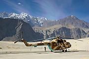 Helicopter on heliport in valleys of Karokoram Mountains, Skardu Valley, North Pakistan