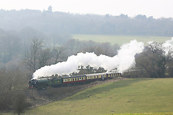 © Licensed to London News Pictures. 12/03/2016. The Tornado steam locomotive drives the British Pullman train through the Surrey Hills on a bright but misty Spring afternoon just outside Guilford. Credit: Rob Powell/LNP