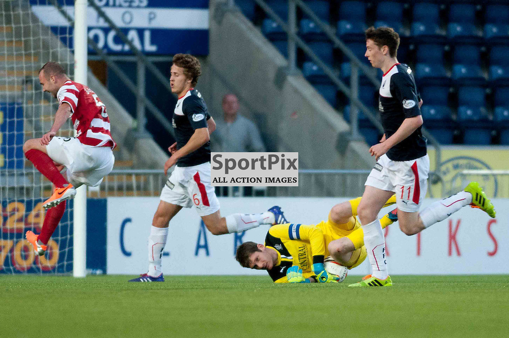 Falkirk hosted Hamilton Academicals in the first leg of the SPFL play off semi final at Falkirk Community Stadium. Michael McGovern dives and collects the ball to break up another Hamilton attack. Tuesday, 13th May, 2014. (c) Wullie Marr | SportPix.org.uk