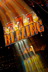 """Blazing 777"" - This slot machine was photographed in a casino in Reno, Nevada. The effect was obtained in camera by long exposure mixed with intentional camera movement."