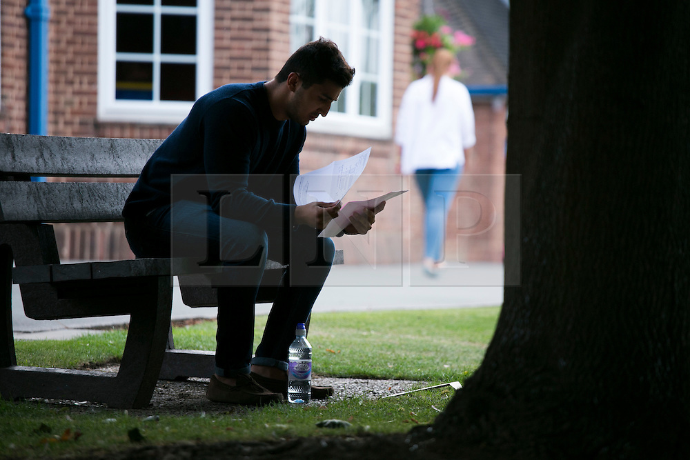 © Licensed to London News Pictures. 13/08/2015. Solihull, West Midlands, UK. A level results day at Solihull School. A record breaking year for the school as it had 88% of students with A Star to B passes. Pictured, a student reads through his results in private. Photo credit : Dave Warren/LNP