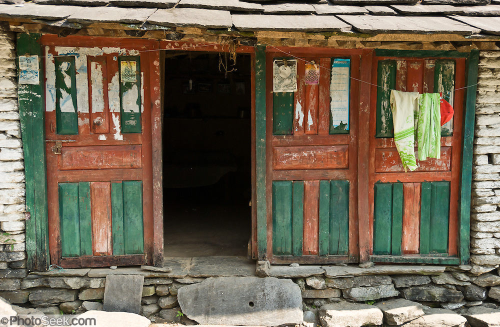 Colorful green and red doors, seen along the trail to Annapurna Sanctuary in Nepal.