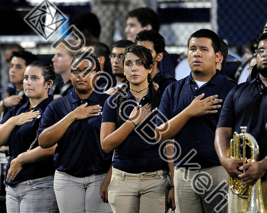 2011 September 01 - Florida International Band of the Sun members stand at attention for the playing of the national anthem. Florida International University Golden Panthers defeated the University of North Texas Mean Green (41-16) in the Alfonso Field at FIU Stadium, Miami, Florida. (Photo by: www.photobokeh.com / Alex J. Hernandez)