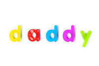 Colorful alphabet magnets spell 'daddy' over white background