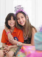 Portrait of boy and girl (10-12) at birthday party