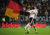 FUSSBALL  INTERNATIONAL  EM 2012  QUALIFIKATION  Deutschland - Belgien                              11.10.2011 Jubel: Mesut OEZIL (li) und Per MERTESACKER (re, beide Deutschland)
