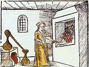 The Chemist, 1508, The Chemist or Alchemist is using bellows to heat up the fire under under a crucible. Behind him an alembic standing on a furnace is being used for distillation. Distillate condenses in rounded hood of alembic and runs down through beak into collecting vessel. From 'Margarita philosophica' ('The Pearl of Philosophy') by Gregor Reisch. (Basle, 1508). This book was an early encyclopaedia of knowledge for students.