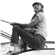 Singer Pete Seeger sailing on the Sloop Woody Guthrie out of Beacon, NY.