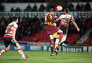 Gary McKenzie challenges for the loose ball during the Sky Bet League 1 match between Doncaster Rovers and Bradford City at the Keepmoat Stadium, Doncaster, England on 3 April 2015. Photo by Glenn Ashley.