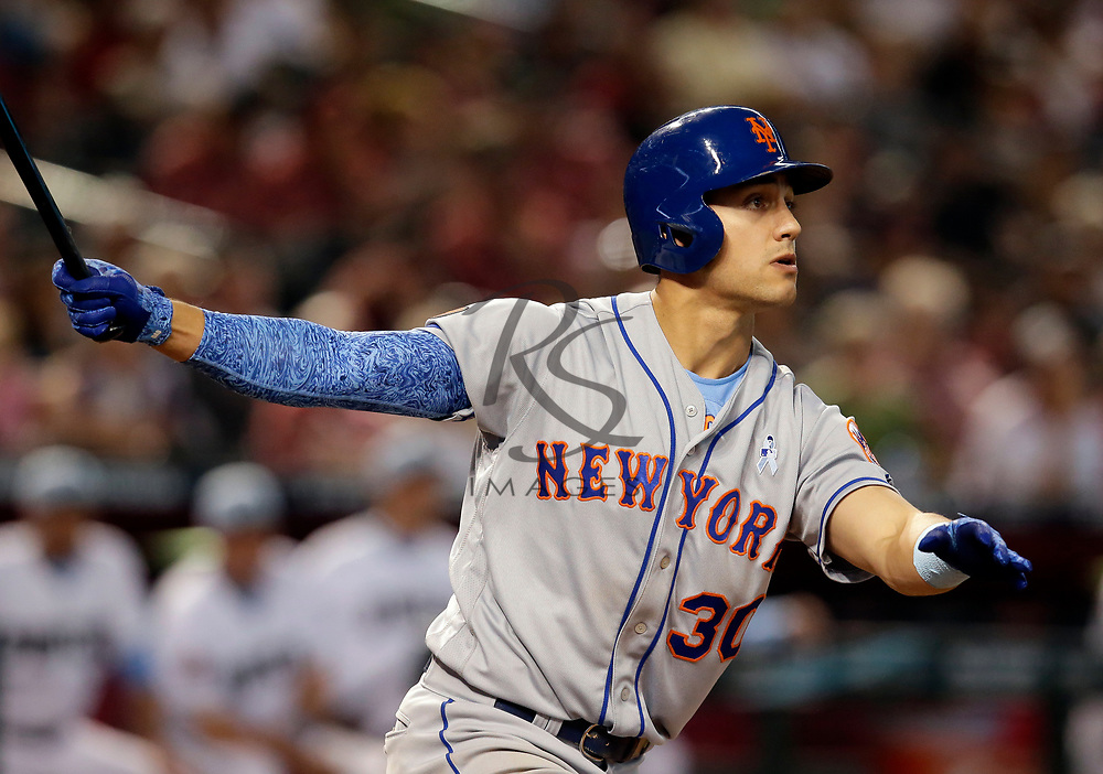 New York Mets left fielder Michael Conforto (30) in the first inning during a baseball game against the Arizona Diamondbacks, Sunday, June 17, 2018, in Phoenix. (AP Photo/Rick Scuteri)
