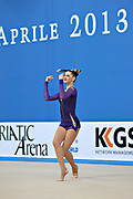 Alina Maksimenko during qualifying at clubs in Pesaro World Cup at the Adriatic Arena on 27 April, 2013.<br /> Alina is an Ukrainian individual rhythmic gymnast. She was born born on July 10, 1991 in Zaporizhia, Ukraine.
