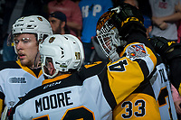 REGINA, SK - MAY 25: Ryan Moore #40 hugs Kaden Fulcher #33 of Hamilton Bulldogs after the semi-final loss to the Regina Pats at the Brandt Centre on May 25, 2018 in Regina, Canada. (Photo by Marissa Baecker/CHL Images)