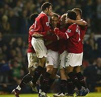 Photo: Aidan Ellis.<br /> Manchester United v Everton. The Barclays Premiership.<br /> 11/12/2005.<br /> United celebrate the equalising goal