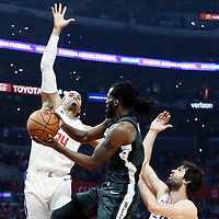 04 March 2018: Brooklyn Nets forward DeMarre Carroll (9) goes past LA Clippers guard Milos Teodosic (4) and LA Clippers forward Tobias Harris (34) during the LA Clippers 123-120 victory over the Brooklyn Nets, at the Staples Center, Los Angeles, California, USA.