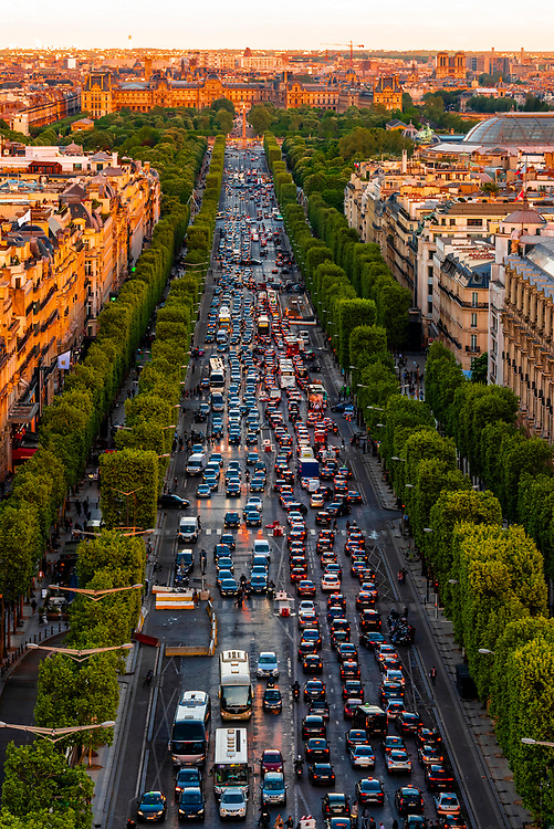 Traffic at sunset along the Champs Elysees, looking from Place de l'Etoile to Place de la Concorde, Paris, France.