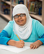 Cunningham Elementary School fifth grader Maryam Al-Saidi poses for a photograph, April 3, 2014.