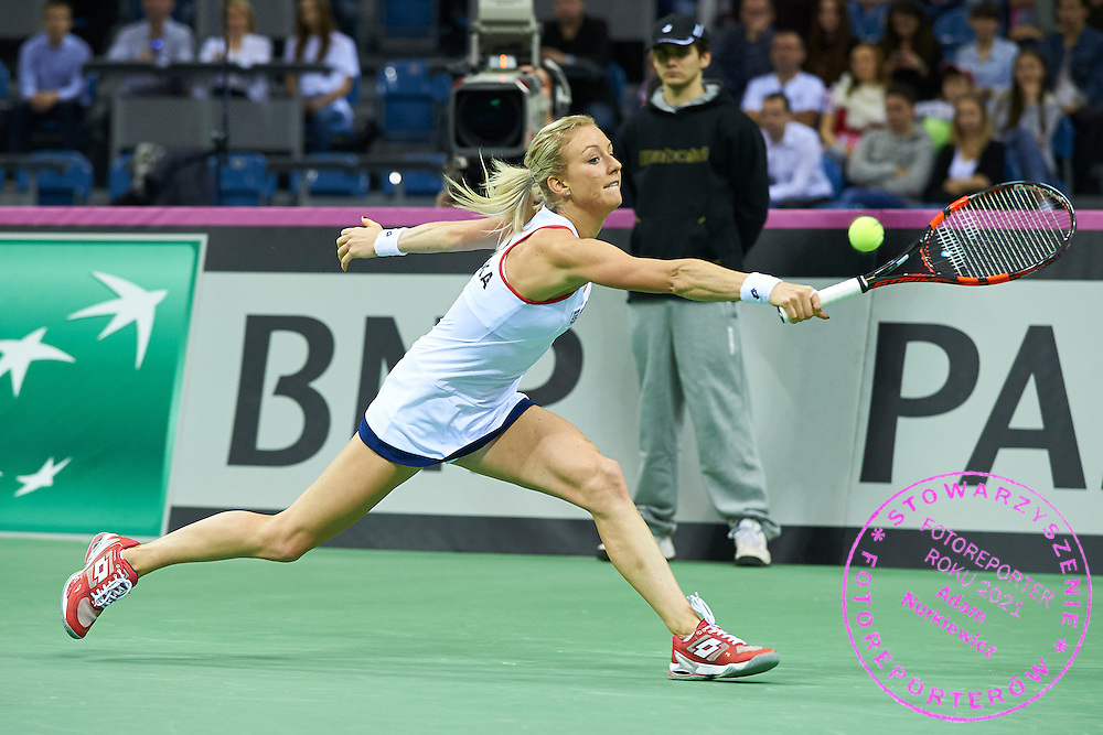Urszula Radwanska from Poland in action during First Day of the Fed Cup / World Group 1st round tennis match between Poland and Russia at Tauron Krakow Arena on February 7, 2015 in Cracow, Poland.<br /> <br /> Poland, Cracow, February 7, 2015<br /> <br /> Picture also available in RAW (NEF) or TIFF format on special request.<br /> <br /> For editorial use only. Any commercial or promotional use requires permission.<br /> <br /> Adam Nurkiewicz declares that he has no rights to the image of people at the photographs of his authorship.<br /> <br /> Mandatory credit:<br /> Photo by &copy; Adam Nurkiewicz / Mediasport